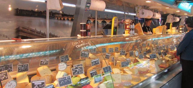 cheese stall. market. French cheese. french food. french market.