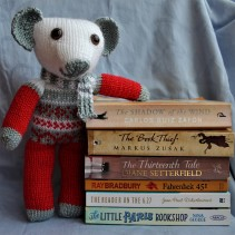 hand-knit teddy and books about books.