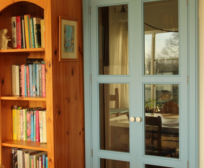 blue pantry doors, cookbooks.