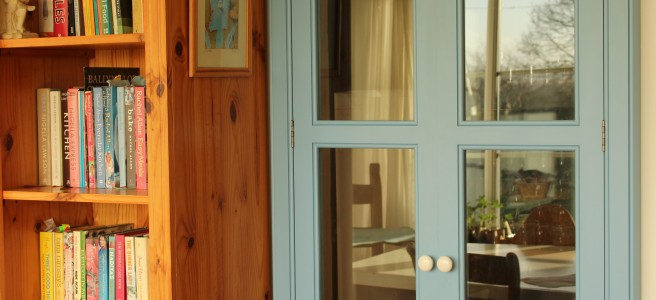 blue pantry doors, cookbooks.